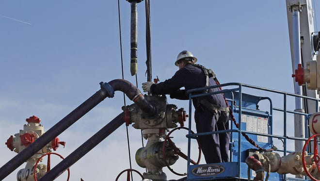 This March 25, 2014 file photo shows perforating tools, used to create fractures in the rock, lowered into one of six wells during a roughly two-week hydraulic fracturing operation at an Encana Corp. well pad near Mead, Colo.