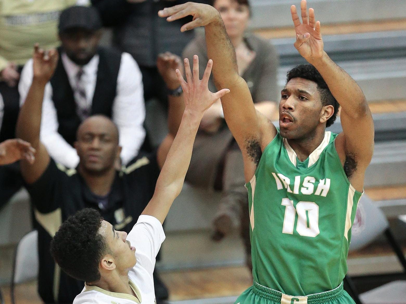 Cathedral's Eron Gordon sinks one of his 31 points over Warren Central's Bishop Smith during the IHSAA Boys Basketball Sectional #10 held at Lawrence Central High School on Tuesday, Mar. 3, 2015. Cathedral won 72-65.