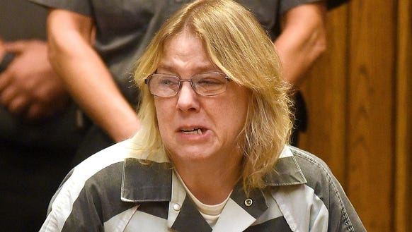 Joyce Mitchell cries in Clinton County Court, Monday,
