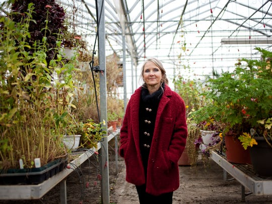 Wendy Greer poses Wednesday, Nov. 12, 2014 at her greenhouse in St. Clair Township.