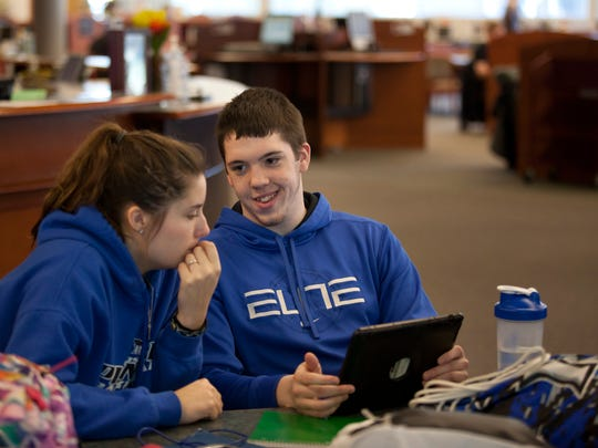 Students Jessica Newberry, 18, and Tyler Drabant, 19, study together for an English class Tuesday at St. Clair County Community College in Port Huron.