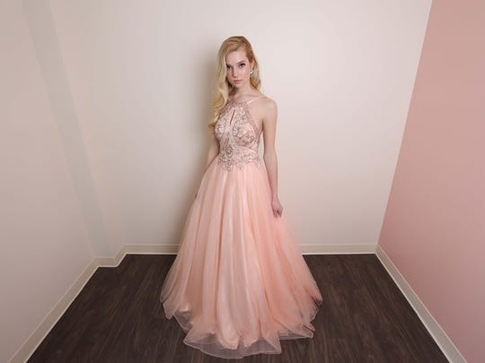 Model, Yuliya Ivan wearing a pink embellished gown from Schaffer's ($649).