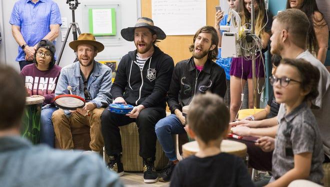 Imagine Dragons band members (from left) Ben McKee, Daniel Platzman, Wayne Sermon and Dan Reynolds sing with patients during a visit to Banner Cardon Children's Medical Center in Mesa, Ariz. Sept. 26, 2017.