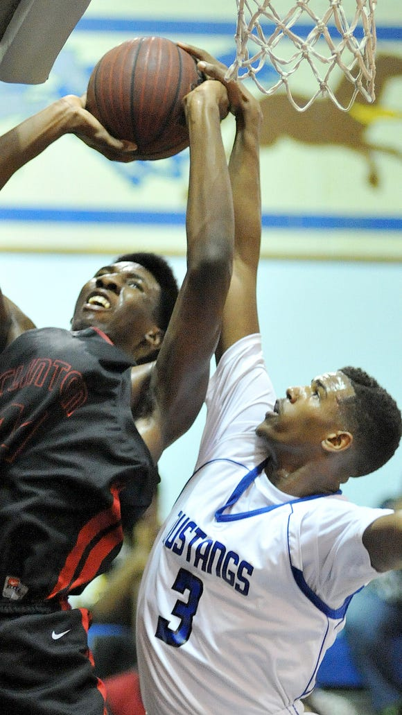 Murrah's Andreco Calender tries to block the shot of Clinton's Isaiah Austin during their game Tuesday  at Murrah.