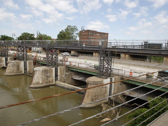 Work on Brown's Race and the Inner Loop area of the Genesee River on June 22, 2015.