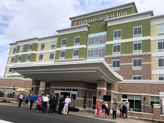 Officials gather outside the new Corning Hilton Garden Inn for a groundbreaking ceremony Thursday.