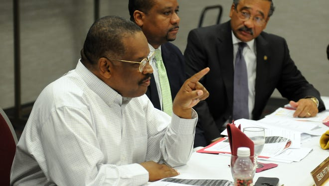 Harold Knowles speaks in this June 2012 photo. Pictured with lobbyist Sean Pittman and then Mayor John Marks.