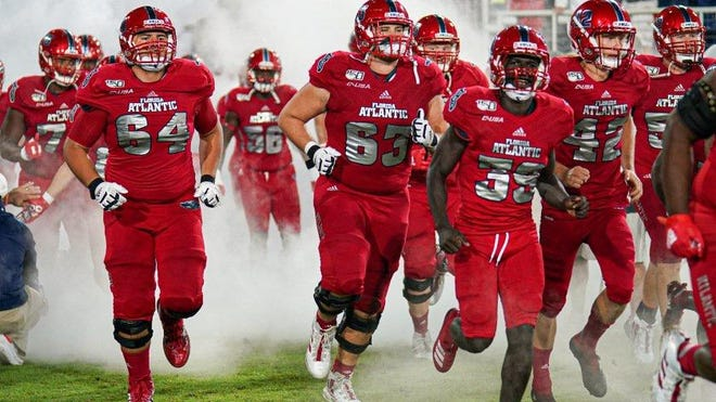 In this 2019 photo, Florida Atlantic players run out of the tunnel before a 37-7 win over FIU.