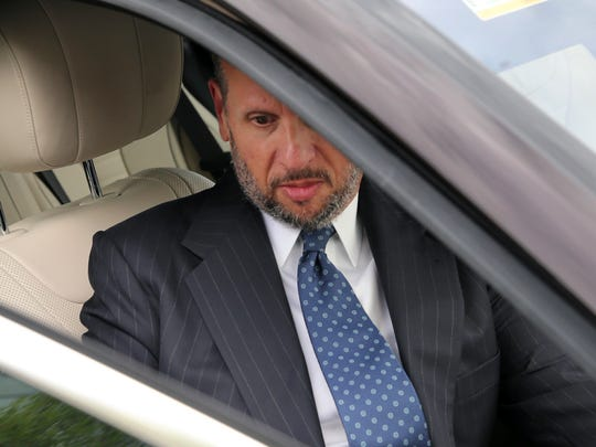 David Wildsteingets into a car as he leaves Martin Luther King Jr. Federal Courthouse after a hearing, Monday, Sept. 26, 2016, in Newark, N.J.