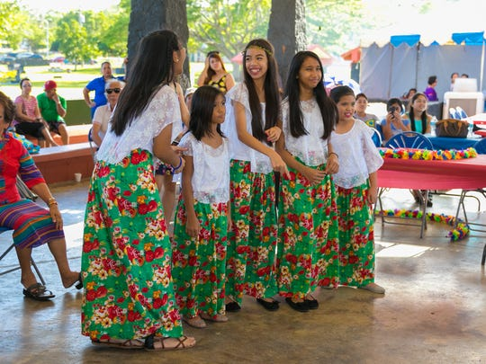 Girls in traditional costumes are photographed during the Pista Sa Nayon Philippine Independence/Father's Day Celebration held at Ypao Beach on June 21, 2015.