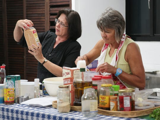 From left, Tammy Agoun and Betty Jo Wresch  cook Mediterranean