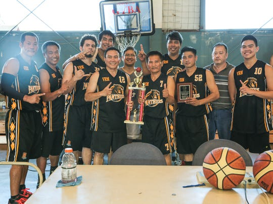 First place winner Panthers are presented a trophy during the Championship basketball game of the Island Sports Association Fun & Fitness League between Sen. Rodriguez Team and Panthers held at Yigo Gym on July 19. Panthers won the championship with a score of Panthers 63 points and Sen. Rodriguez Team 56 points.