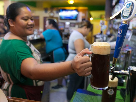 Draft beers are featured prominently during Oktoberfest celebrations at Mc Kraut's in Maloloj. Festivities begin Sept. 24.