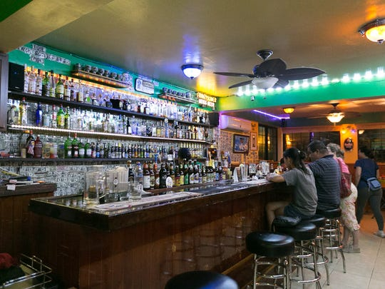 Various German beers and liquors are displayed inside the bar at McKraut's Bar and Restaurant.