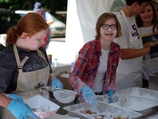 Volunteers prepare beignet orders at the 2017 Cafe du Memphis.