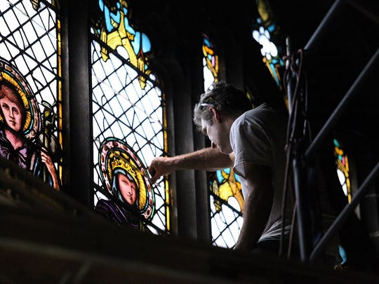 A window restoration project at Asheville's Trinity