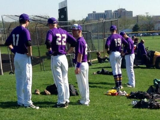 Players from Lancaster Catholic try to maintain their focus during a 45-minute wait for umpires on Thursday.