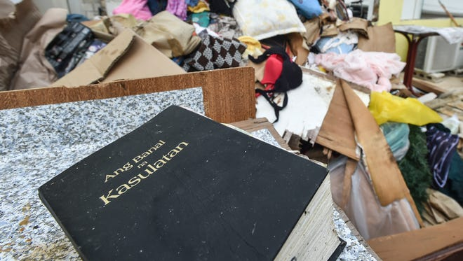A Filipino bible rests on a table of a destroyed home in Garapn, Saipan on Aug. 13 following Typhoon Soudelor.