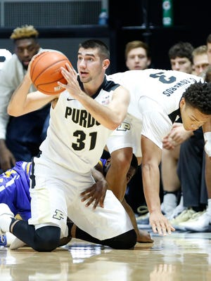 Dakota Mathias comes up with a loose ball in front of the Purdue bench against Morehead State Saturday, December 3, 2016, at Mackey Arena. Purdue defeated Morehead State 90-56.