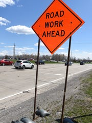 Road construction alert signs already dot the southbound lanes of M-5 in Novi on April 17 as work is slated to begin on the north-south route beginning April 22.