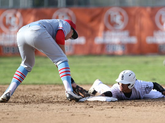 South Salem's Gabe Matthews reaches to tag North Salem's Sean Alvarado as the Saxons defeat North Salem 8-1 on Friday, April 8, 2016, during a Greater Valley Conference game.
