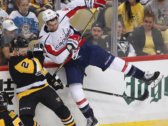 Pittsburgh Penguins' Chad Ruhwedel (2) collides with