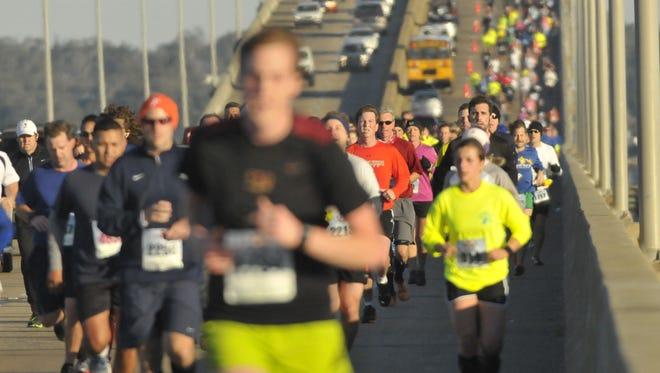 In this file photo, runners cross the Pensacola Bay Bridge during the 16th annual Pensacola Double Bridge Run Saturday morning Feb. 2, 2013.