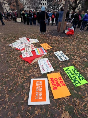 Protest signs lie on the ground during a Capitol gun-rights rally in Richmond, Va., Monday, Jan. 16, 2017. (Bob Brown/Richmond Times-Dispatch via AP)