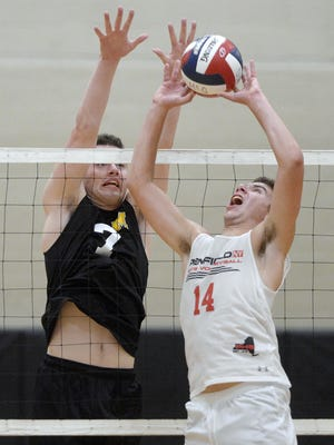 Penfield's Joe Farruggia, right, sets the ball as McQuaid's Brady Darby defends during a regular season game at McQuaid Jesuit High School on Wednesday, Sept. 20, 2017. McQuaid beat Penfield 3-1 (25-19, 26-24, 19-25, 25-17).