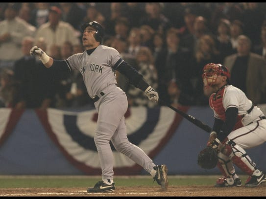 Jim Leyritz watches the ball fly during after hitting