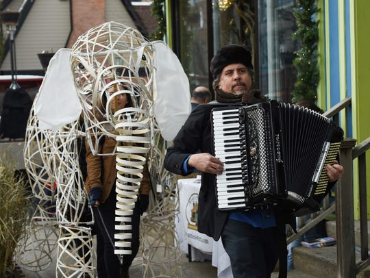 Performers travel down East Market Street in Rhinebeck during Sinterklaas Day.