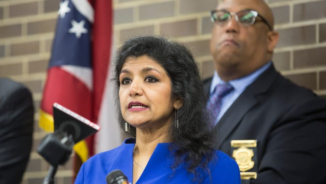 Hamilton County's Dr. Lakshmi Sammarco discusses 2016 heroin overdose numbers during a press conference at her office in Corryville. At right is Cincinnati Police Chief Eliot Isaac.