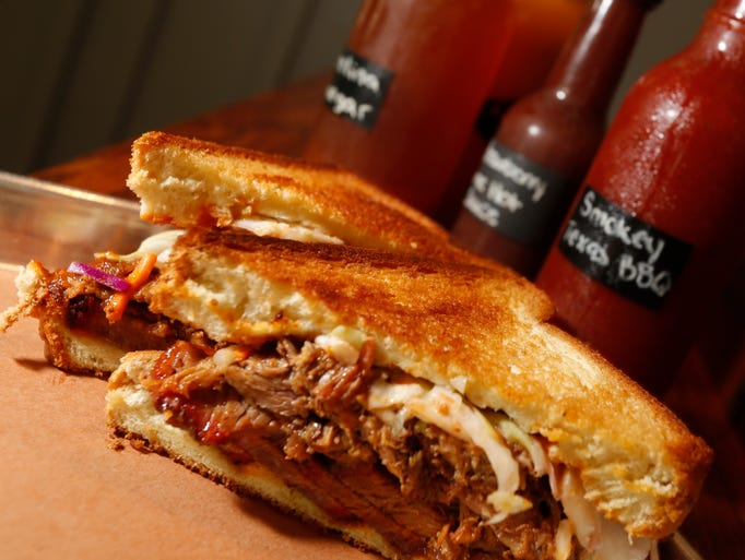 The Por Brisken with sliced brisket, cole slaw served on Texas toast and Apple Bourbon sauce, one of the several items offered at Northern Smoke in Carmel on July 8, 2014.