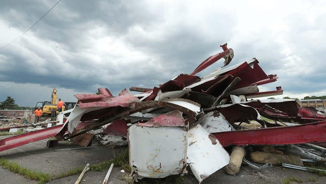 The stands of the former Norton High School football stadium sit in a mangled pile as a demolition crew from Butcher and Son of Norton takes down the field's press box and stands Thursday, June 25, 2020 in Norton, Ohio.