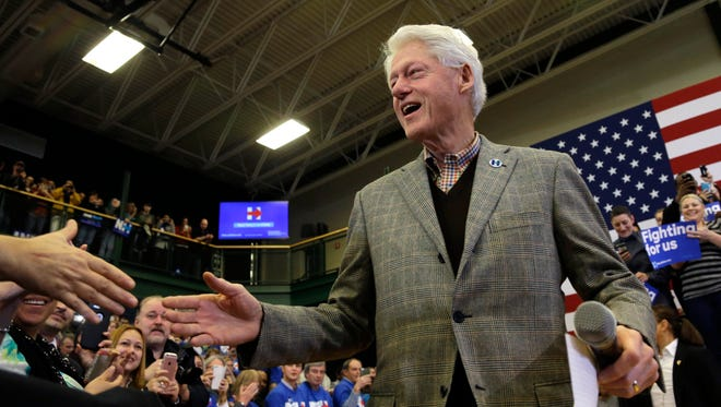 Former President Bill Clinton greets a supporter at a campaign event for Democratic presidential candidate Hillary Clinton, Tuesday, Feb. 2, 2016, in Nashua, N.H. (AP Photo/Elise Amendola)
