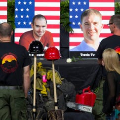 """Alumni of the Granite Mountain Hotshots view photographs of the 19 fallen firefighters killed in the Yarnell Hill Fire before the """"Our Fallen Brother"""" memorial service at Tim's Toyota Center in Prescott Valley on July 9, 2013."""
