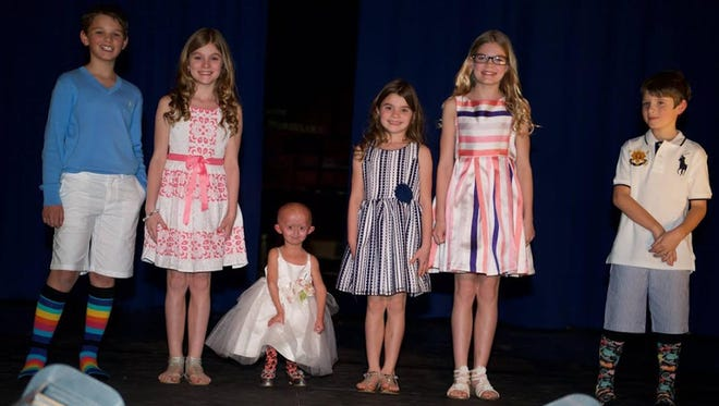 On March 20, 2016, Mountain Lakes High School hosted its seventh annual fashion show to benefit Team Zoey and The Progeria Research Foundation. Zoey Astor Penny is a 7-year-old girl who has progeria and is working with the rest of Team Zoey to raise awareness and help fight this extremely rare condition. Progeria is a fatal disease that prematurely ages kids many times faster than normal, affecting approximately one in eight million newborns. The fashion show raised more than $11,000. From left: Aidan Penny, Halle Schulke, Zoey, Anna Schulke, Grace Schulke and Gavin Penny.