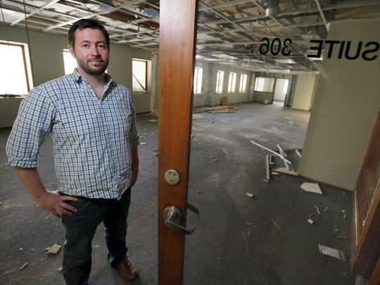 Geoff Wood stands on the third floor of the Midland Building in downtown Des Moines during the floor's transformation into Gravitate, a startup co-working space.