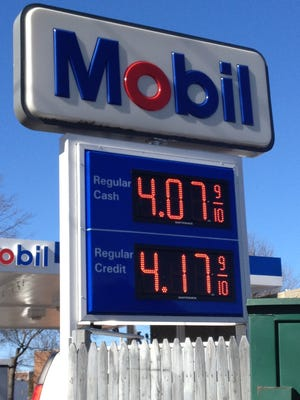 Remember the sticker shock in February, 2013? (Seen here at a White Plains gas station.) Now that the prices at the pump have plummeted, a letter writer says it's time to fix the extra charge for credit-card purchases.