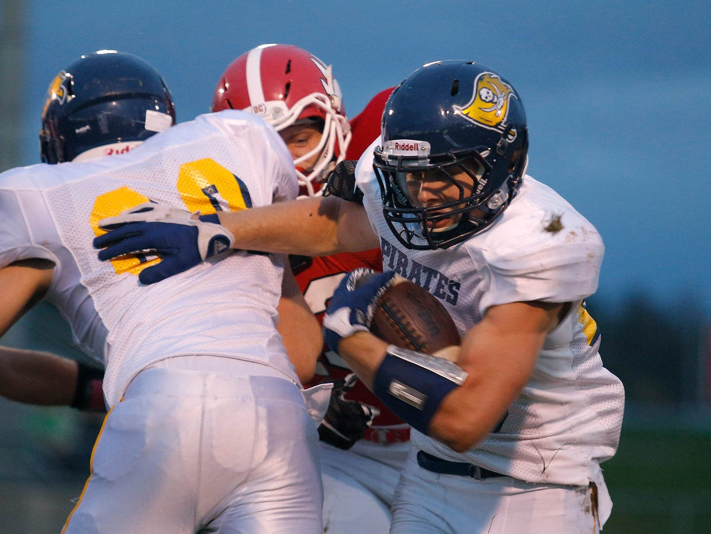 Pewamo-Westphalia's Jared Smith, right, rushes against Laingsburg's Dan Harkness Friday, Oct. 9, 2015, in Laingsburg, Mich. Pewamo-Westphalia won 50-7.