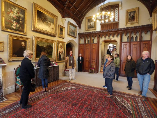 Rick Hostnik, leads a tour of the art gallery in Lyndhurst