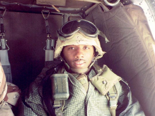 Olaudah Parker tours Kuwait and southern Iraq in helicopter with his colonel during the first Gulf War.