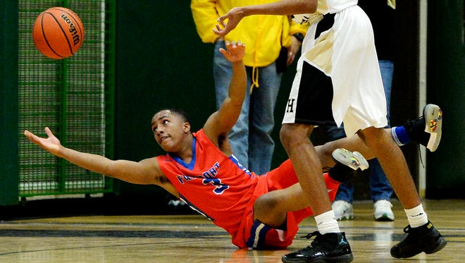 Fairport's Andre Starks reaches for a loose ball during a regular season game at Rush-Henrietta High School on Monday, Jan. 8, 2018. Fairport beat Rush-Henrietta 74-56.