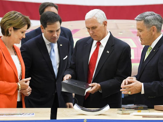 Vice President Mike Pence (second from right) looks at thermal tiles for the Orion capsule with Lockheed Martin CEO Marillyn Hewson (left) Sen. Marco Rubio and KSC Director Robert Cabana (far right).