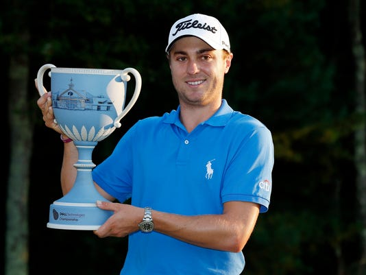 Justin Thomas holds the trophy after winning the Dell Technologies Championship golf tournament at TPC Boston in Norton, Mass., Monday, Sept. 4, 2017. (AP Photo/Michael Dwyer)
