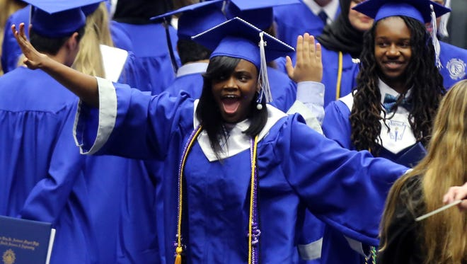 Graduates celebrate after receiving their diplomas at the MLK High School graduation ceremony held Saturday May 14, 2016 at Lipscomb's Allen Arena.