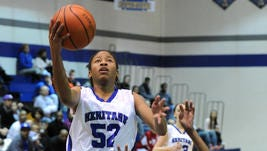 Heritage Christian's Tyasha Harris shoots a layup on a fast break in front of Pike's Amber Morgan, Saturday, January 4, 2014
