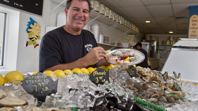 Ken Degnan prepares shrimp, clams and oysters at his Runners Seafood Restaurant and Market in the Ocean Beach 1 section of Toms River.
