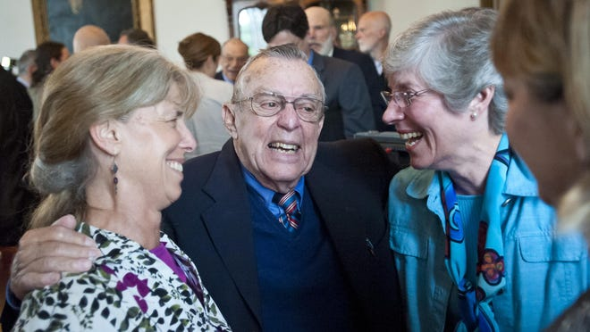 Dick Walters of Shelburne, center, president of Patient Choices Vermont,celebrates with daughter Betsy Walters Walkerman of Underhill, from left, Marnie Wood of Middlebury and daughter Nancy Howley of Milton after Gov. Peter Shumlin signed the end-of-life bill at the Statehouse in Montpelier on May 20, 2013.