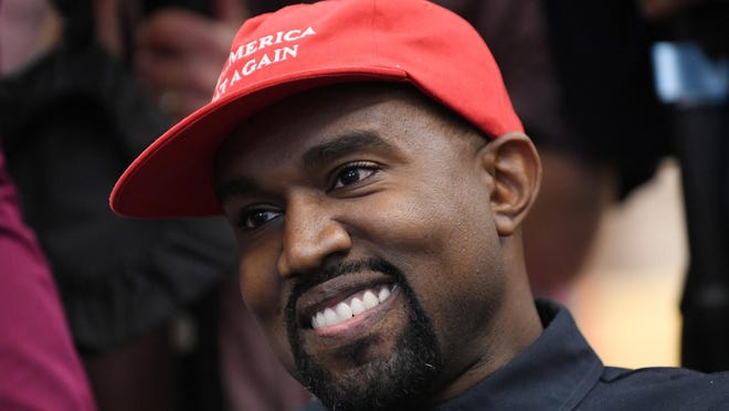 Musical artist Kanye West looks on in the Oval Office of the White House during a meeting with President Donald Trump on October 11, 2018, in Washington, D.C.
